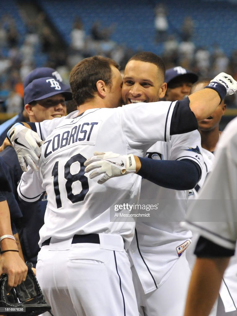 Infielder Ben Zobrist #18 of the Tampa Bay Rays hugs pinch hitter James Loney #21 after a home run in the bottom of the 9th inning to defeat the Baltimore Orioles 5 - 4 September 23, 2013 at Tropicana Field in St. Petersburg, Florida.
