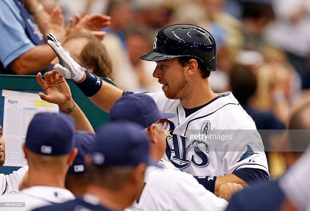 Infielder <a gi-track='captionPersonalityLinkClicked' href=/galleries/search?phrase=Ben+Zobrist&family=editorial&specificpeople=2120037 ng-click='$event.stopPropagation()'>Ben Zobrist</a> #18 of the Tampa Bay Rays is congratulated after his fourth inning solo home run against the Baltimore Orioles during the Opening Day game at Tropicana Field on April 2, 2013 in St. Petersburg, Florida.