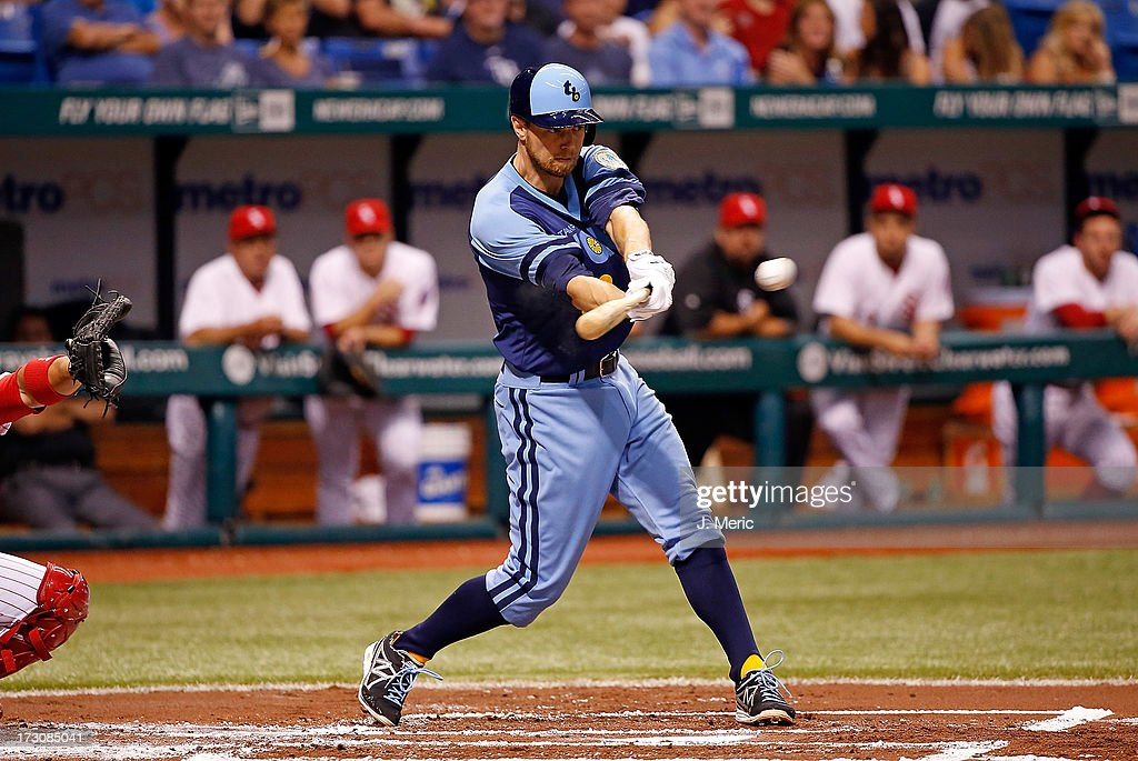 Infielder <a gi-track='captionPersonalityLinkClicked' href=/galleries/search?phrase=Ben+Zobrist&family=editorial&specificpeople=2120037 ng-click='$event.stopPropagation()'>Ben Zobrist</a> #18 of the Tampa Bay Rays singles in the first inning against the Chicago White Sox during the game at Tropicana Field on July 6, 2013 in St. Petersburg, Florida.