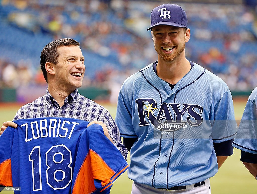Infielder Ben Zobrist #18 of the Tampa Bay Rays smiles as he receives his all star jersey from Executive VP of Baseball Operations, Andrew Friedman just before the start of the game against the Houston Astros at Tropicana Field on July 14, 2013 in St. Petersburg, Florida.
