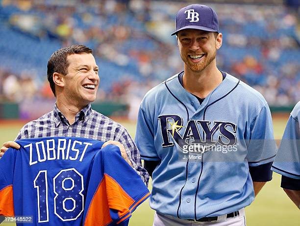 Infielder Ben Zobrist of the Tampa Bay Rays smiles as he receives his all star jersey from Executive VP of Baseball Operations Andrew Friedman just...