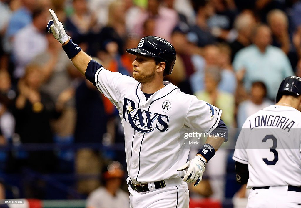 Infielder <a gi-track='captionPersonalityLinkClicked' href=/galleries/search?phrase=Ben+Zobrist&family=editorial&specificpeople=2120037 ng-click='$event.stopPropagation()'>Ben Zobrist</a> #18 of the Tampa Bay Rays waves to the crowd after his fourth inning solo home run against the Baltimore Orioles during the Opening Day game at Tropicana Field on April 2, 2013 in St. Petersburg, Florida.