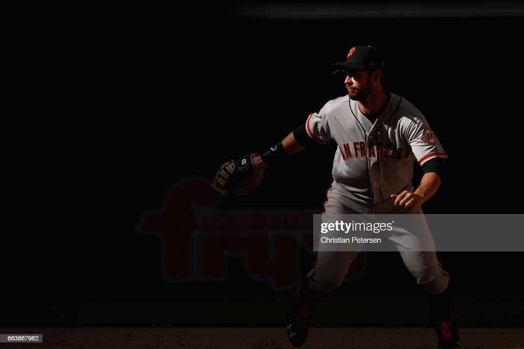 Infielder Brandon Belt #9 of the San Francisco Giants covers first base during the MLB opening day game against the Arizona Diamondbacks at Chase Field on April 2, 2017 in Phoenix, Arizona. The Diamondbacks defeated the Giants 6-5.
