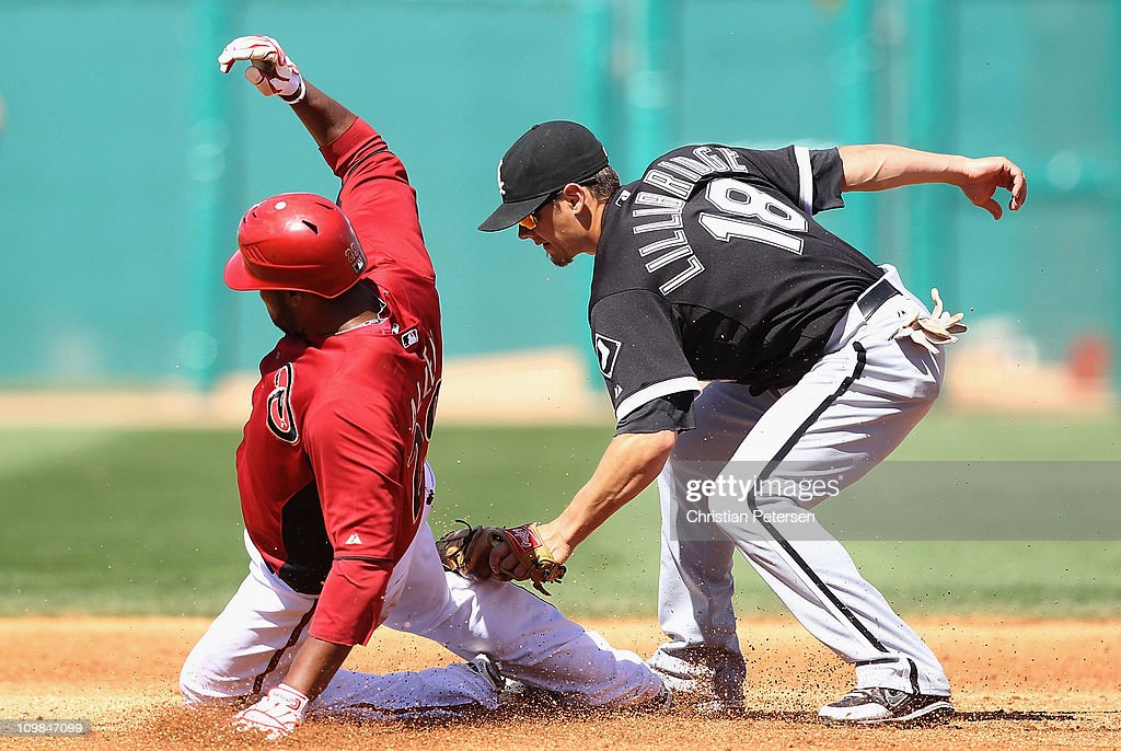 Infielder Brent Lillibridge #18 of the Chicago White Sox tags out <a gi-track='captionPersonalityLinkClicked' href=/galleries/search?phrase=Brandon+Allen+-+Baseball+Player&family=editorial&specificpeople=2238262 ng-click='$event.stopPropagation()'>Brandon Allen</a> #29 of the Arizona Diamondbacks as he attempts to steal second base during the spring training game at Kino Veterans Memorial Stadium on March 7, 2011 in Tucson, Arizona. The charity game is to benefit the 9-year-old Christina-Taylor Green Memorial Fund. Green was a victim of the Tucson shooting on January 8th.