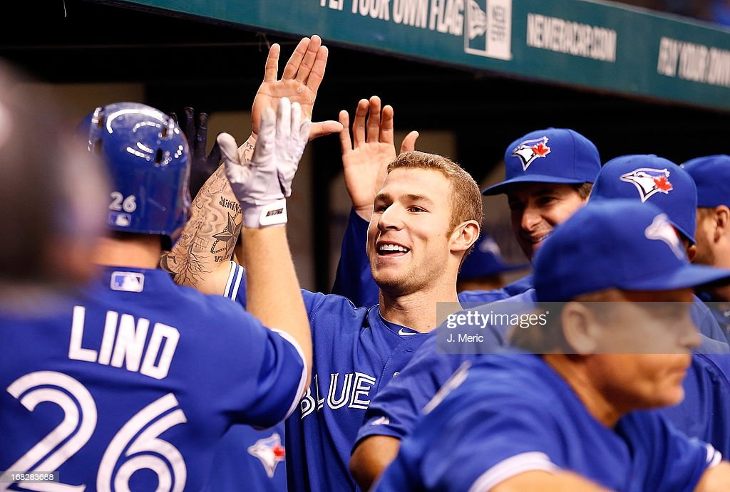 Infielder <a gi-track='captionPersonalityLinkClicked' href=/galleries/search?phrase=Brett+Lawrie&family=editorial&specificpeople=5496694 ng-click='$event.stopPropagation()'>Brett Lawrie</a> #13 of the Toronto Blue Jays celebrates <a gi-track='captionPersonalityLinkClicked' href=/galleries/search?phrase=Adam+Lind&family=editorial&specificpeople=3911783 ng-click='$event.stopPropagation()'>Adam Lind</a>'s home run against the Tampa Bay Rays during the game at Tropicana Field on May 7, 2013 in St. Petersburg, Florida.
