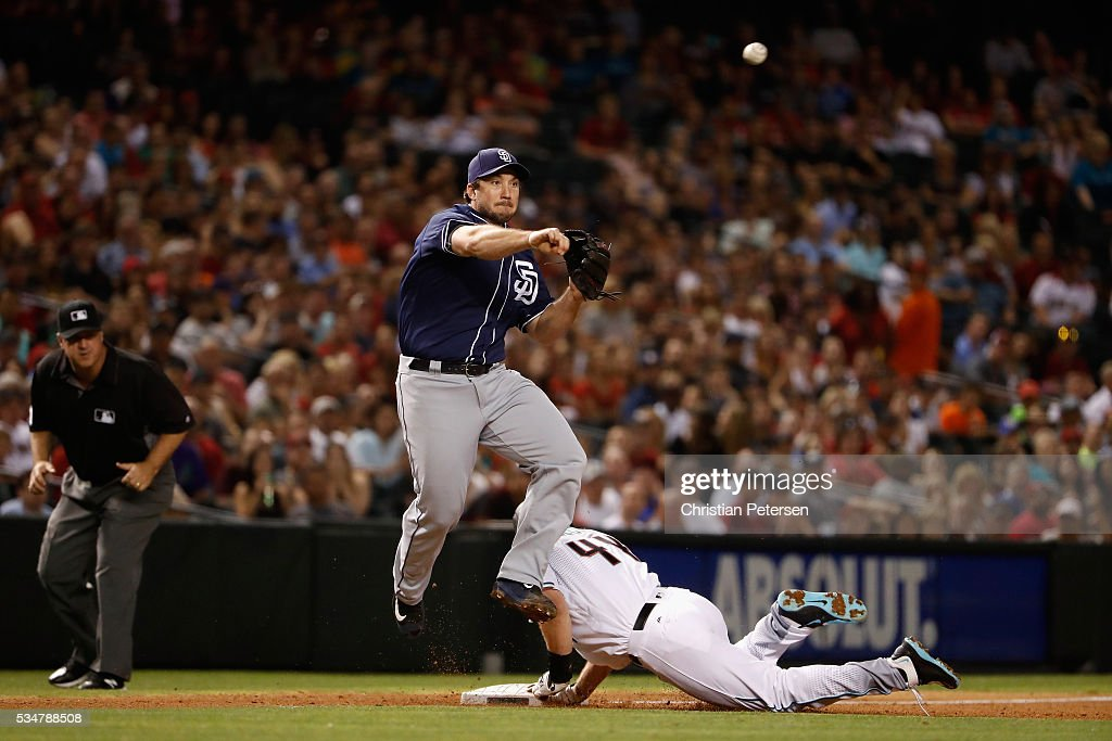 Infielder Brett Wallace of the San Diego Padres throws to first base after getting a forceout on Paul Goldschmidt of the Arizona Diamondbacks during...