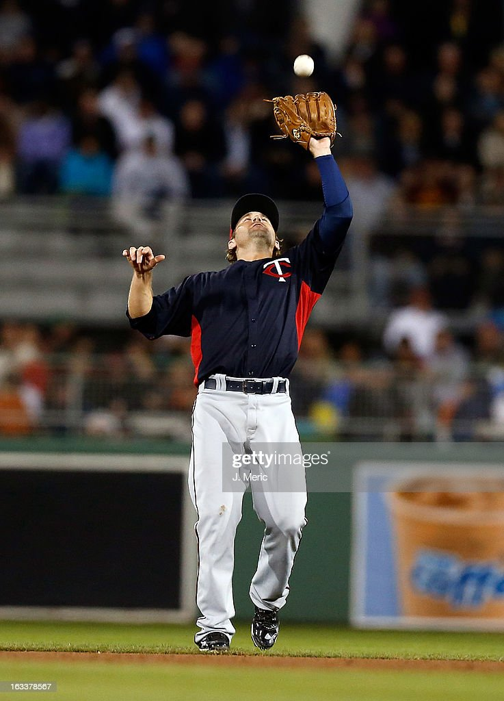 Infielder Brian Dozier #2 of the Minnesota Twins catches a fly ball against the Boston Red Sox during a Grapefruit League Spring Training Game at JetBlue Park on March 8, 2013 in Fort Myers, Florida.