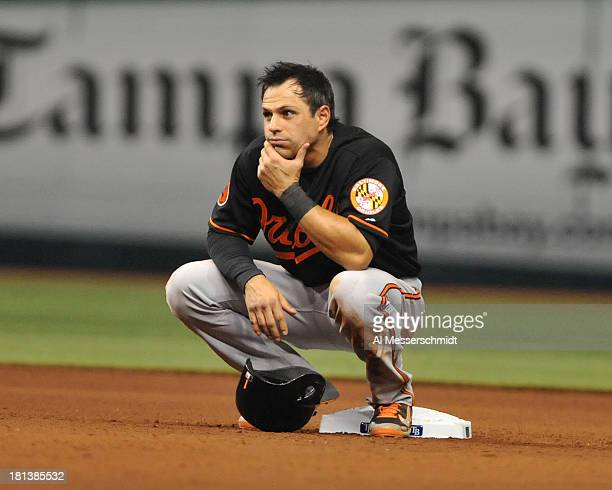 Infielder Brian Roberts of the Baltimore Orioles crouches at 2nd base while the Tampa Bay Rays change pitchers September 20 2013 at Tropicana Field...