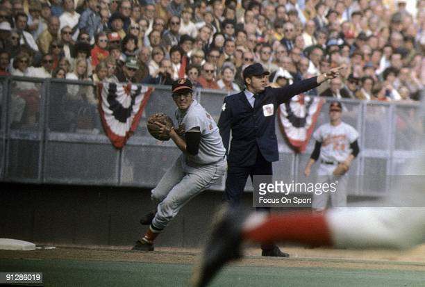 Infielder Brooks Robinson of the Baltimore Orioles in action at third base against the Cincinnati Reds during a world series game October 1970 at...