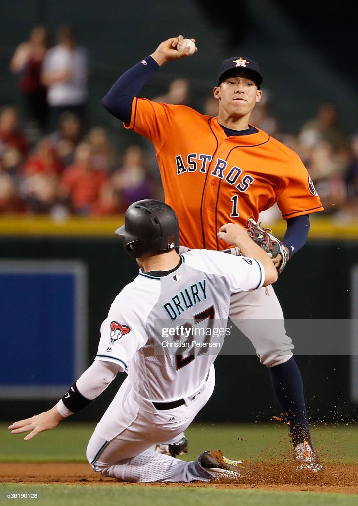 Infielder <a gi-track='captionPersonalityLinkClicked' href=/galleries/search?phrase=Carlos+Correa+-+Baseball+Player&family=editorial&specificpeople=11452157 ng-click='$event.stopPropagation()'>Carlos Correa</a> #1 of the Houston Astros gets a force out at second base on the sliding Brandon Drury #27 of the Arizona Diamondbacks during the first inning of the MLB game at Chase Field on May 31, 2016 in Phoenix, Arizona.