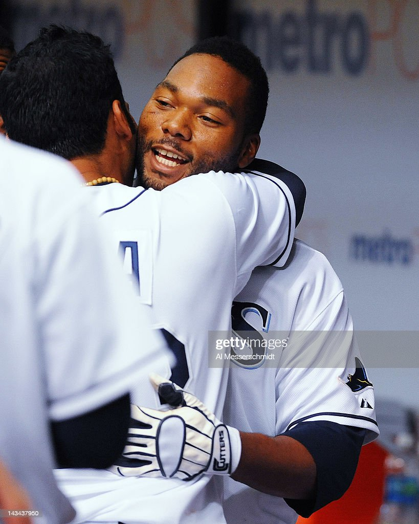 Infielder Carlos Pena #23 hugs pinch hitter <a gi-track='captionPersonalityLinkClicked' href=/galleries/search?phrase=Brandon+Allen+-+Baseball+Player&family=editorial&specificpeople=2238262 ng-click='$event.stopPropagation()'>Brandon Allen</a> #19 of the Tampa Bay Rays in the dugout after a two-run, ninth-inning game-ending home run against the Los Angeles Angels April 26, 2012 at Tropicana Field in St. Petersburg, Florida. The Rays won 4 - 3.