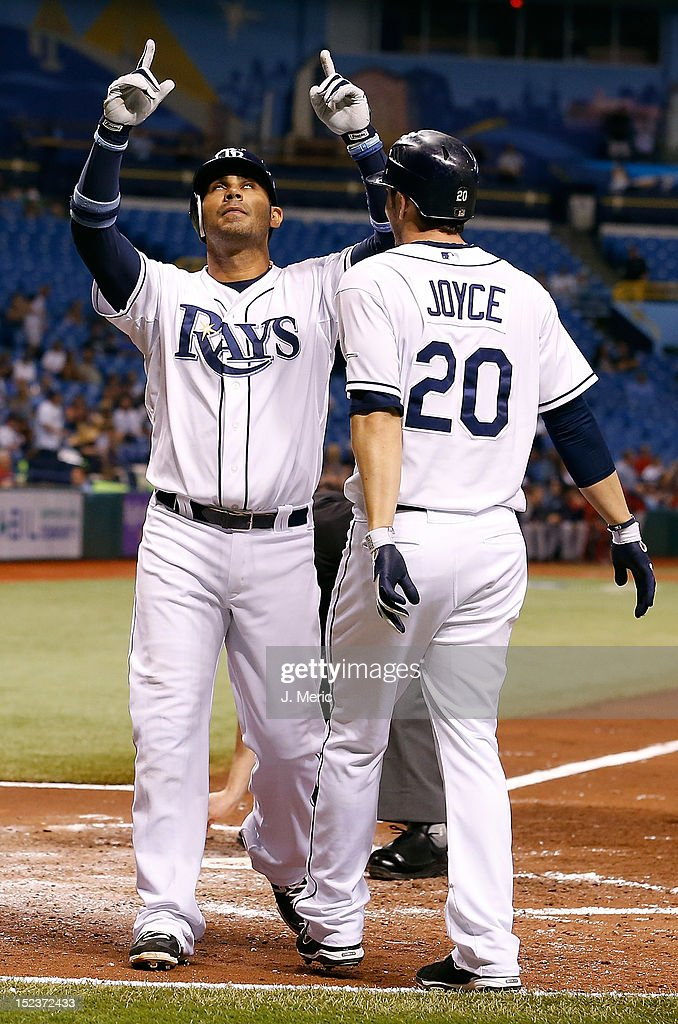Infielder Carlos Pena #23 of the Tampa Bay Rays celebrates his two run home run against the Boston Red Sox during the game at Tropicana Field on September 19, 2012 in St. Petersburg, Florida.