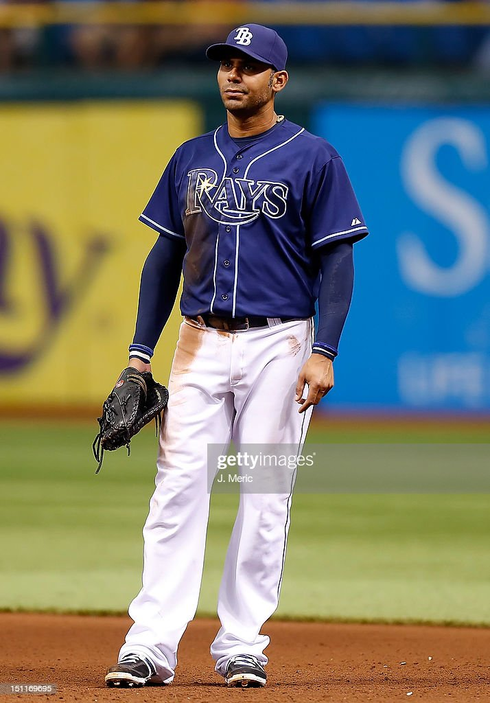 Infielder Carlos Pena #23 of the Tampa Bay Rays plays first base against the Oakland Athletics during the game at Tropicana Field on August 25, 2012 in St. Petersburg, Florida.
