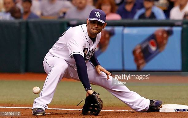 Infielder Carlos Pena of the Tampa Bay Rays takes the throw at first against the Baltimore Orioles during the game at Tropicana Field on September 29...