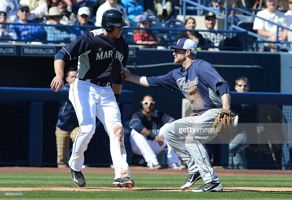 Infielder <a gi-track='captionPersonalityLinkClicked' href=/galleries/search?phrase=Chase+Headley&family=editorial&specificpeople=4353228 ng-click='$event.stopPropagation()'>Chase Headley</a> #7 of the San Diego Padres tags out Michael Saunders #55 of the Seattle Mariners during the spring training game at Peoria Sports Complex on February 24, 2013 in Peoria, Arizona.