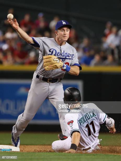 Infielder Chase Utley of the Los Angeles Dodgers throws over the sliding Tony Perezchica of the Arizona Diamondbacks attempting an unsuccessful...