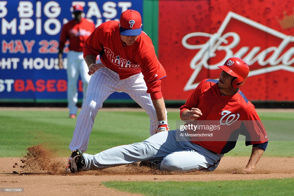 Infielder <a gi-track='captionPersonalityLinkClicked' href=/galleries/search?phrase=Chase+Utley&family=editorial&specificpeople=161391 ng-click='$event.stopPropagation()'>Chase Utley</a> #26 of the Philadelphia Phillies tags sliding infielder Matt Skole #26 of the Washington Nationals March 6, 2013 at Bright House Field in Clearwater, Florida.