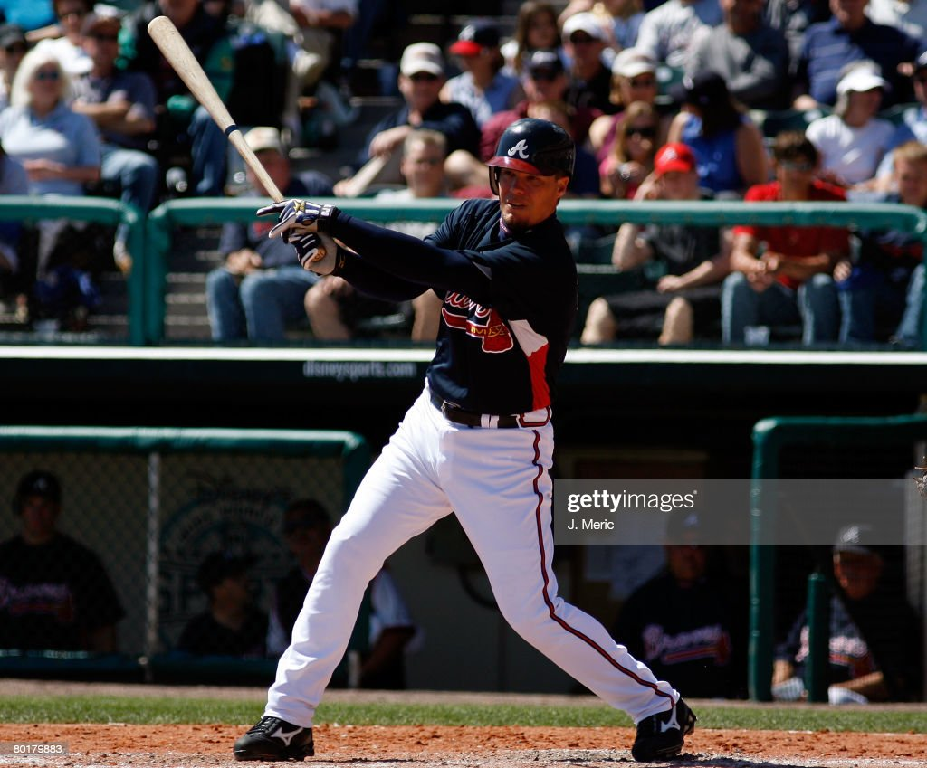 Infielder Chipper Jones of the Atlanta Braves fouls off a pitch against the St Louis Cardinals during the Grapefruit League Spring Training game on...