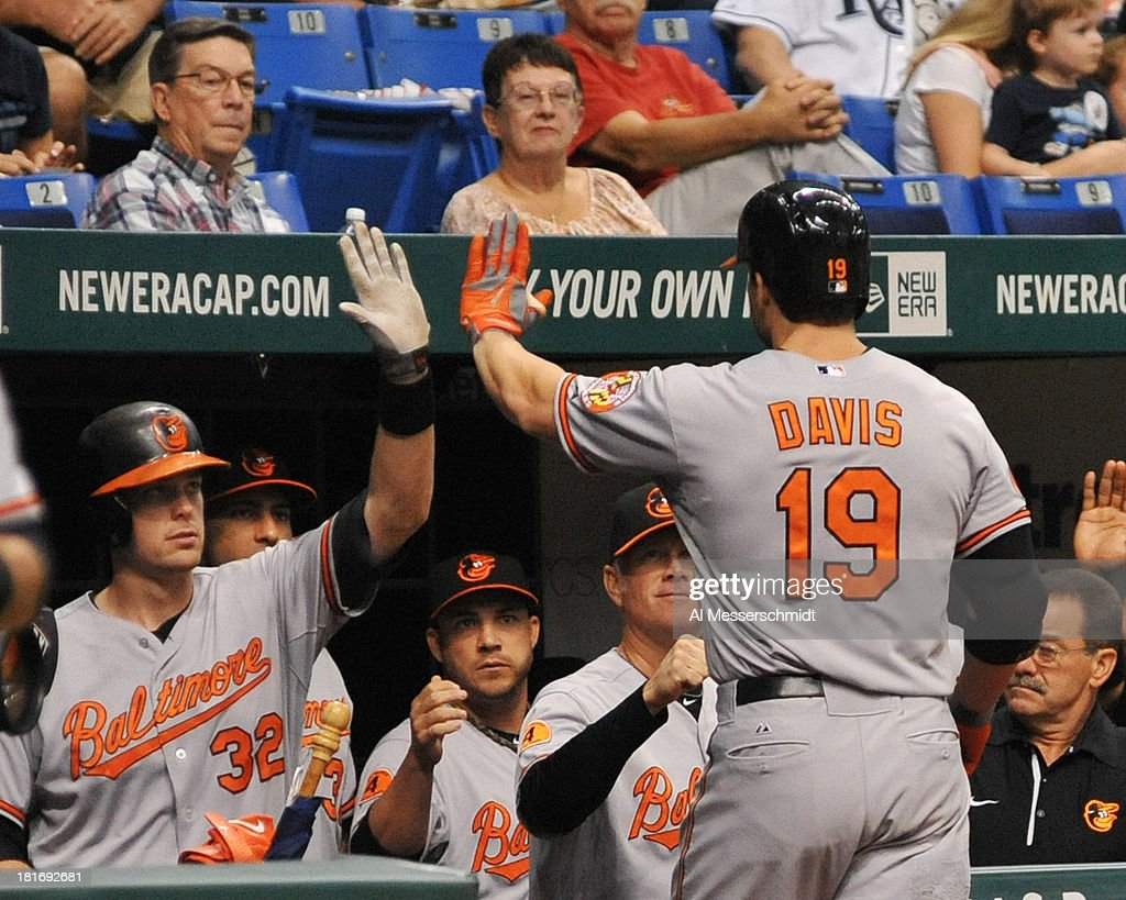 Infielder Chris Davis #19 of the Baltimore Orioles celebrates after a home run in the 4th inning against the Tampa Bay Rays September 23, 2013 at Tropicana Field in St. Petersburg, Florida.