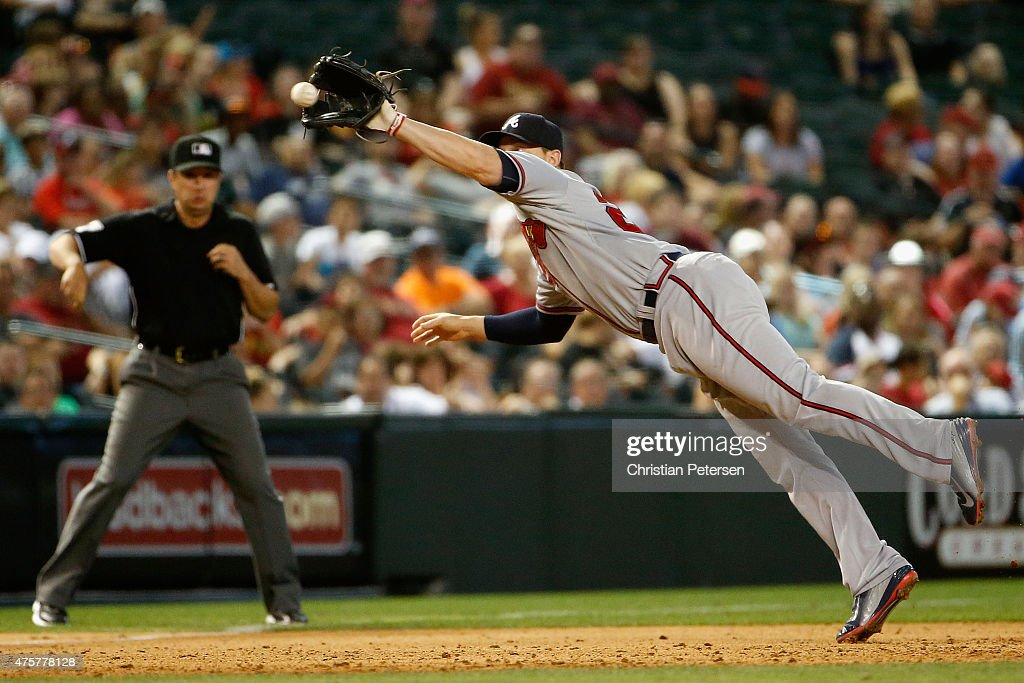 Infielder Chris Johnson of the Atlanta Braves catches a line drive out against the Arizona Diamondbacks during the sixth inning of the MLB game at...
