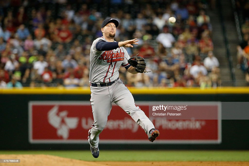 Infielder Chris Johnson of the Atlanta Braves fields an infield single during the second inning of the MLB game against the Arizona Diamondbacks at...