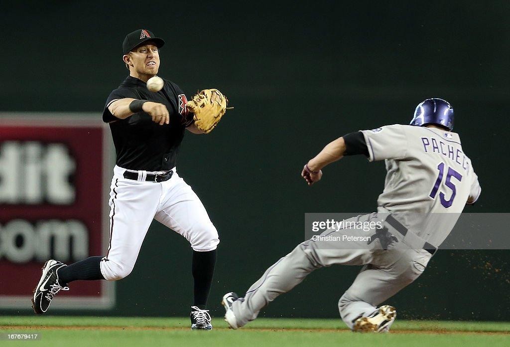 Infielder Cliff Pennington #4 of the Arizona Diamondbacks throws over the sliding Jordan Pacheco #15 of the Colorado Rockies to complete a double play during the first inning of the MLB game at Chase Field on April 27, 2013 in Phoenix, Arizona.