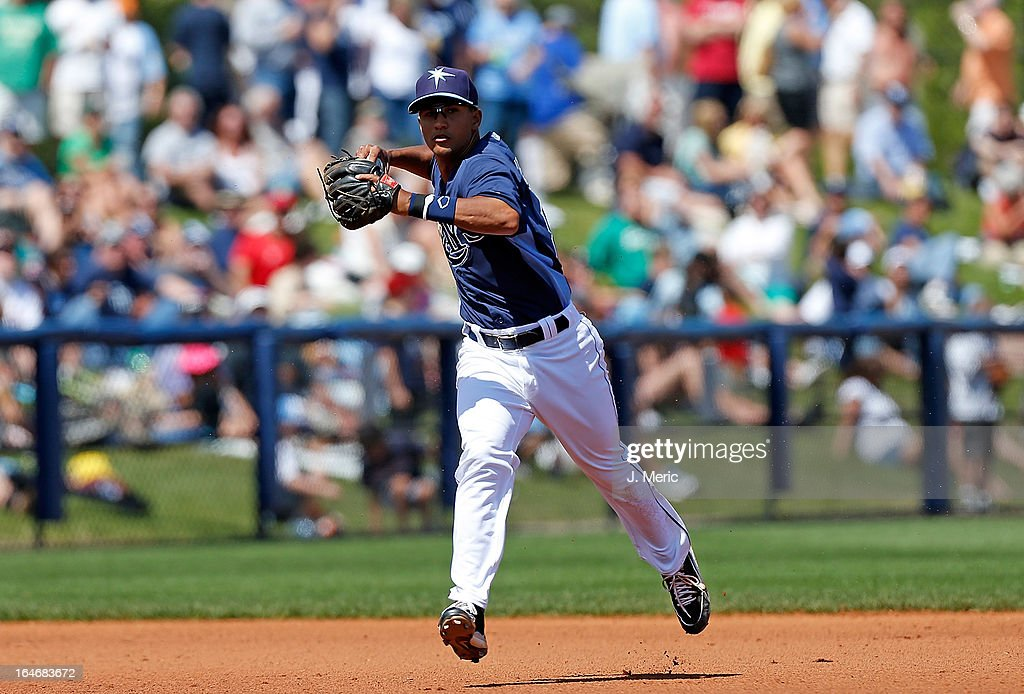 Infielder Cole Figueroa #87 of the Tampa Bay Rays throws over to first for an out against the Boston Red Sox during a Grapefruit League Spring Training Game at the Charlotte Sports Complex on March 16, 2013 in Port Charlotte, Florida.