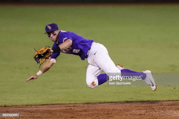 LSU infielder Cole Freeman dives for an overthrown ball during the Baton Rouge Division I Super Regional game between Mississippi St and LSU at Alex...