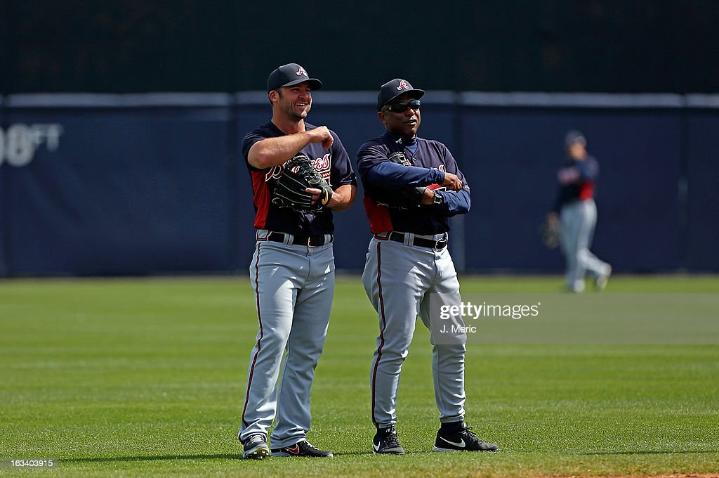 Infielder Dan Uggla #26 of the Atlanta Braves talks with coach Terry Pendelton #9 during batting practice just before the start of the Grapefruit League Spring Training Game against the New York Yankees at George M. Steinbrenner Field on March 9, 2013 in Tampa, Florida.