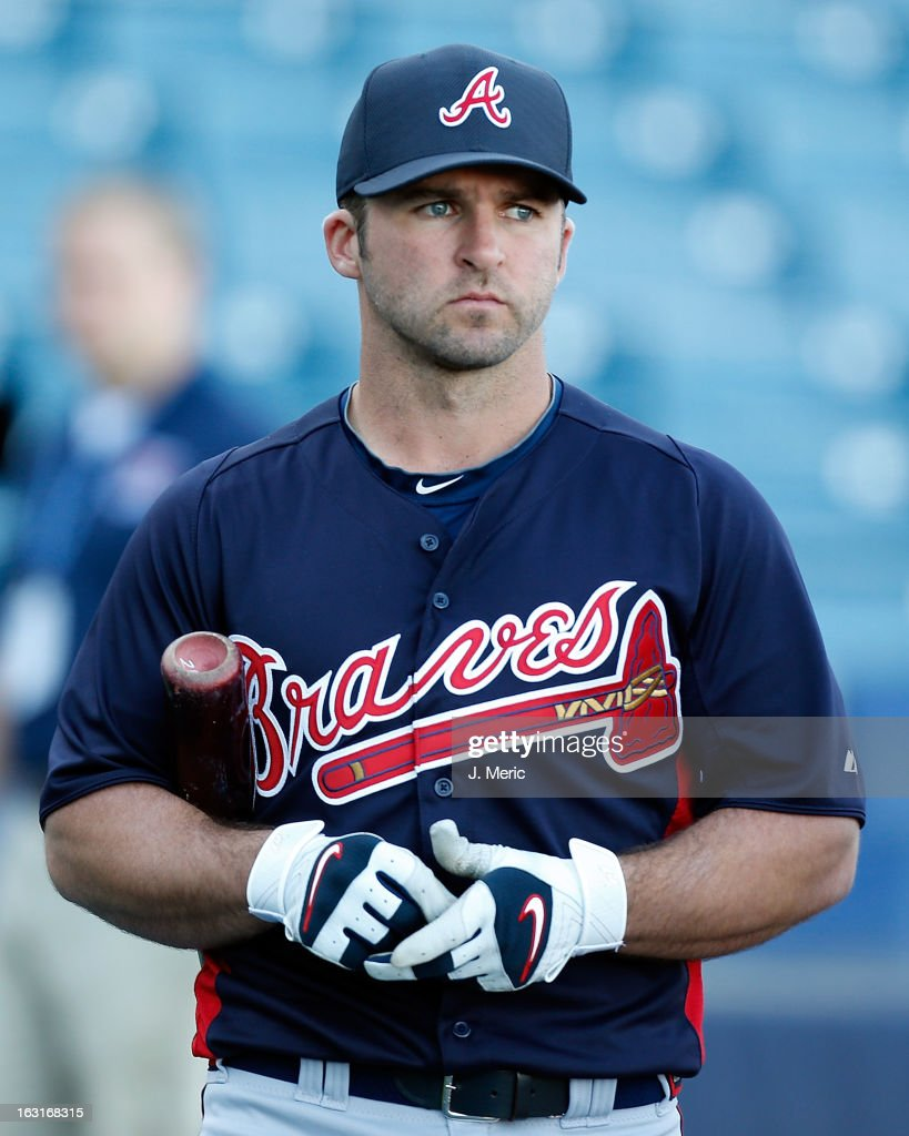 Infielder Dan Uggla #26 of the Atlanta Braves watches batting practice just before the start of the Grapefruit League Spring Training Game against the New York Yankees at George M. Steinbrenner Field on March 5, 2013 in Tampa, Florida.