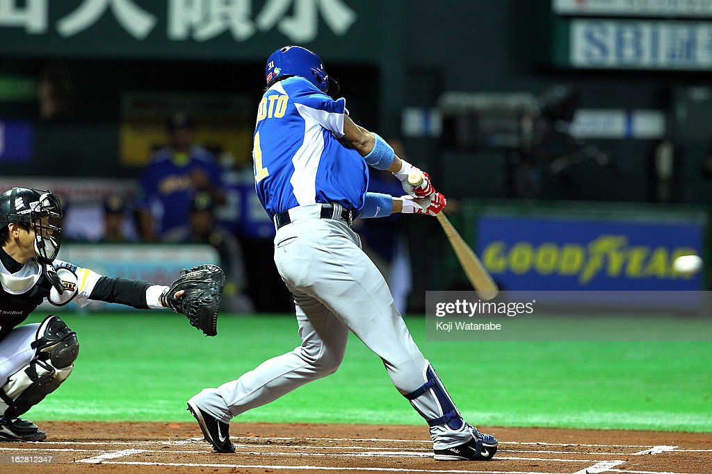 Infielder Daniel Matsumoto #31 of Brazil hits a single in the top half of the first inning during the friendly game between Fukuoka Softbank Hawks and Brazil at Fukuoka Yafuoku! Dome on February 28, 2013 in Fukuoka, Japan.