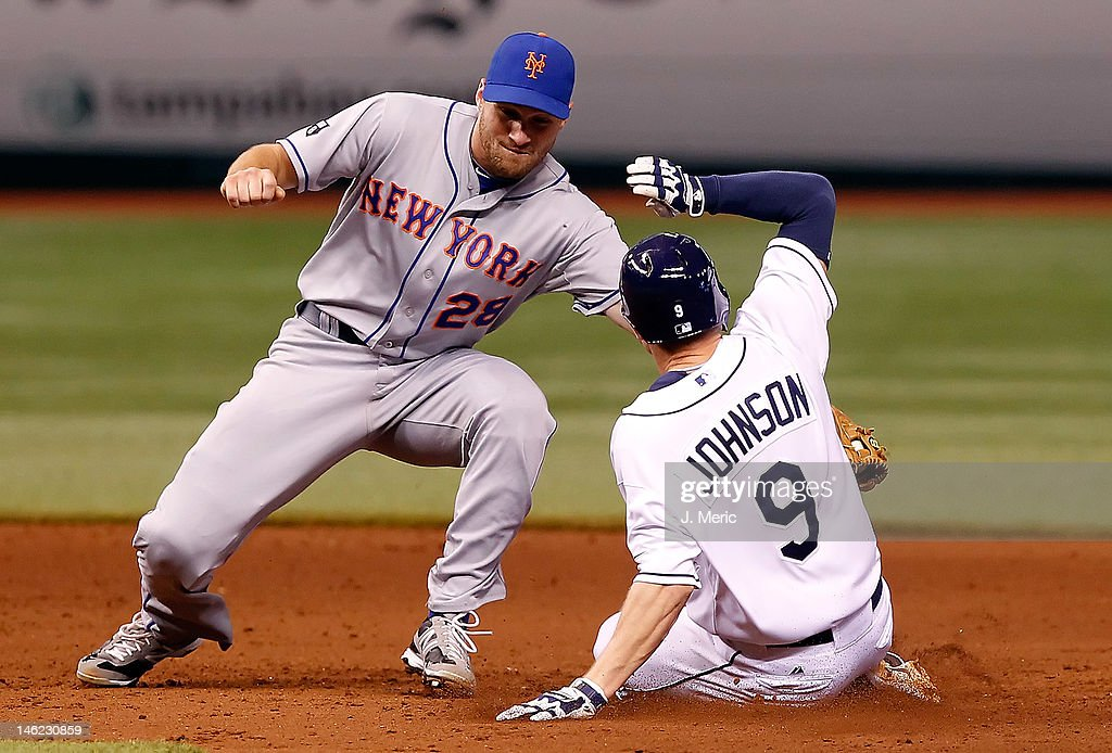 Infielder Daniel Murphy #28 of the New York Mets applies the tag to infielder <a gi-track='captionPersonalityLinkClicked' href=/galleries/search?phrase=Elliot+Johnson+-+Baseball+Player&family=editorial&specificpeople=4175454 ng-click='$event.stopPropagation()'>Elliot Johnson</a> #9 of the Tampa Bay Rays as he is out at second during the game at Tropicana Field on June 12, 2012 in St. Petersburg, Florida.