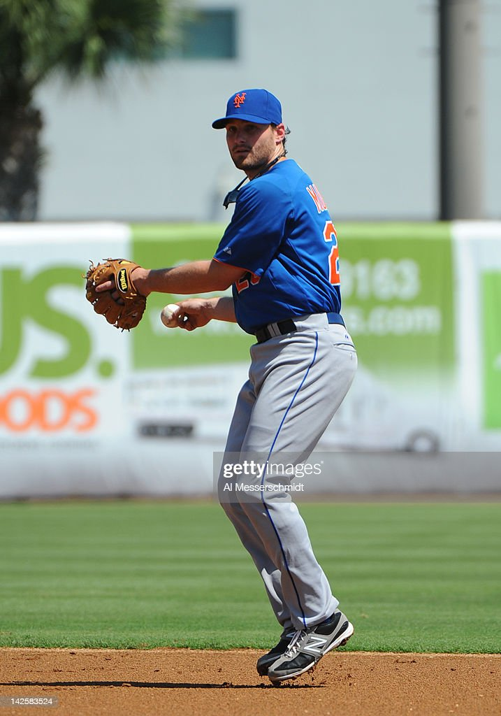 Infielder Daniel Murphy #28 of the New York Mets throws to first base against the New York Yankees in a spring training game April 4, 2012 at George M. Steinbrenner Field in Tampa, Florida.