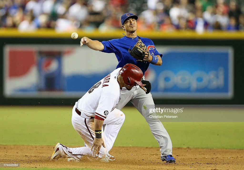 Infielder <a gi-track='captionPersonalityLinkClicked' href=/galleries/search?phrase=Darwin+Barney&family=editorial&specificpeople=537975 ng-click='$event.stopPropagation()'>Darwin Barney</a> #15 of the Chicago Cubs throws over the sliding <a gi-track='captionPersonalityLinkClicked' href=/galleries/search?phrase=Gerardo+Parra&family=editorial&specificpeople=4959447 ng-click='$event.stopPropagation()'>Gerardo Parra</a> #8 of the Arizona Diamondbacks to complete a double play during the eighth inning of the MLB game at Chase Field on July 25, 2013 in Phoenix, Arizona.