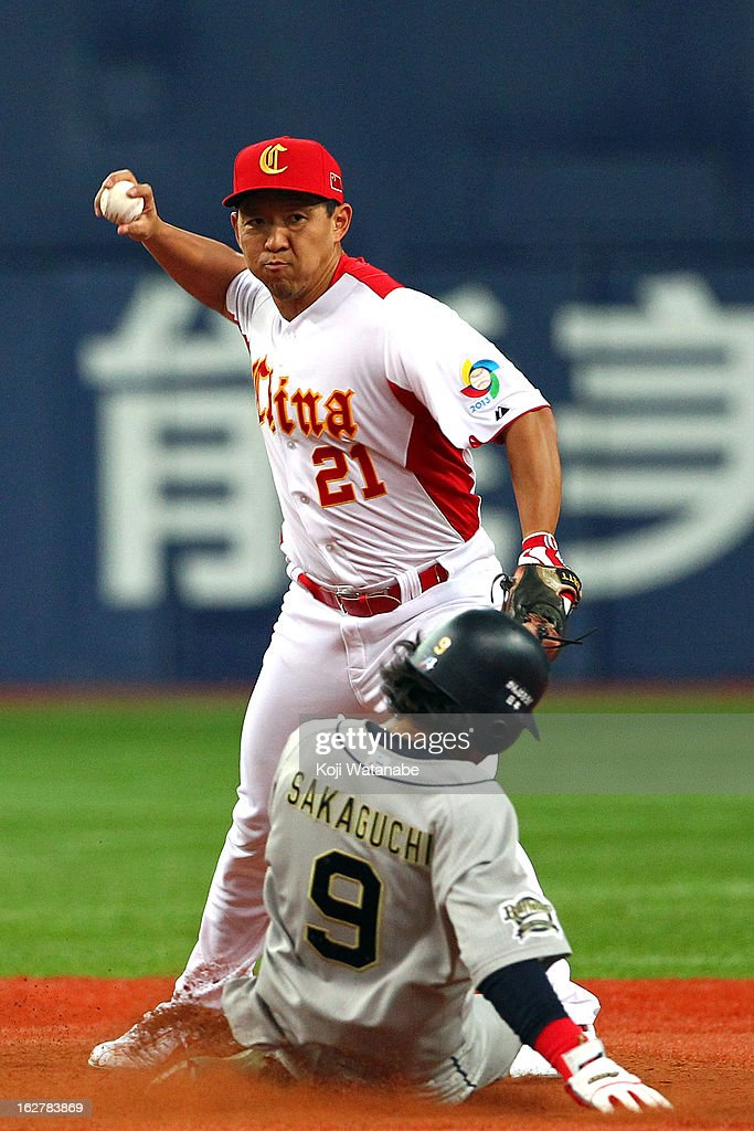 Infielder Delong Jia #31 of China put-out in the bottom half of the third inning during the friendly game between Orix Buffaloes and China at Kyocera Dome Osaka on February 27, 2013 in Osaka, Japan.