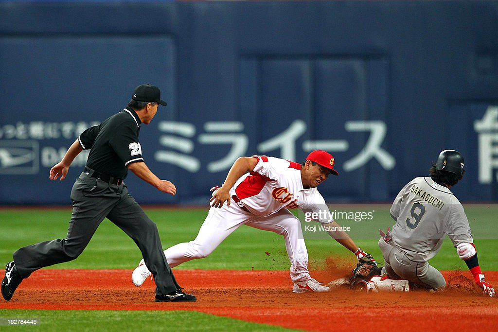 Infielder Delong Jia #31 of China tagged out in the bottom half of the fourth inning during the friendly game between Orix Buffaloes and China at Kyocera Dome Osaka on February 27, 2013 in Osaka, Japan.