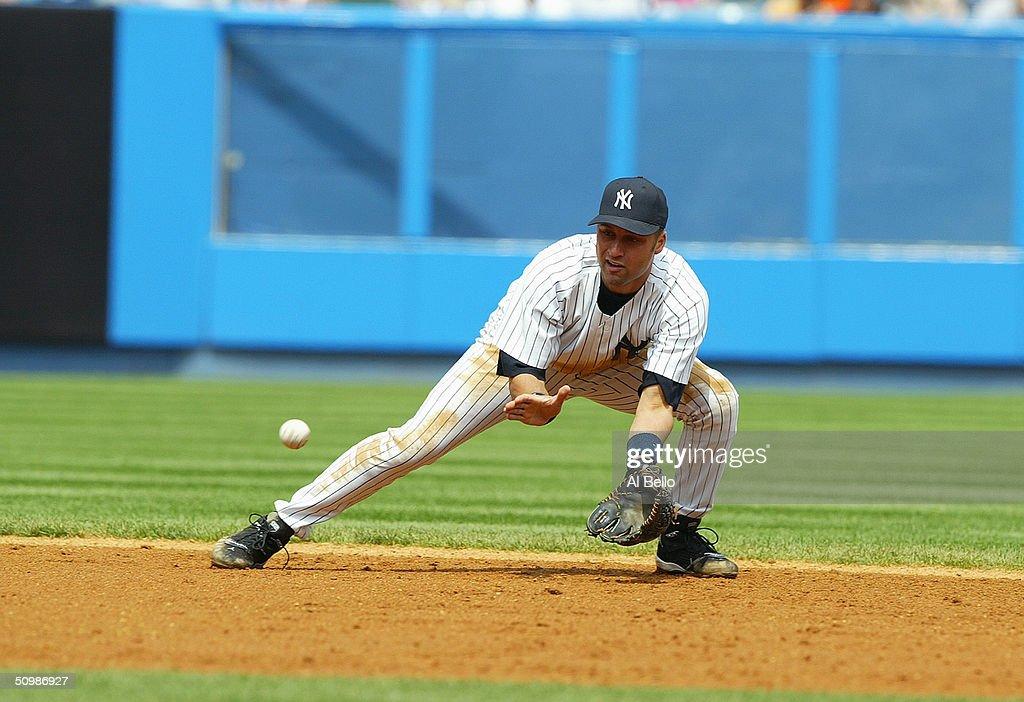 Infielder Derek Jeter of the New York Yankees attempts to catch the ball during the game against the Kansas City Royals at Yankee Stadium on May 1...