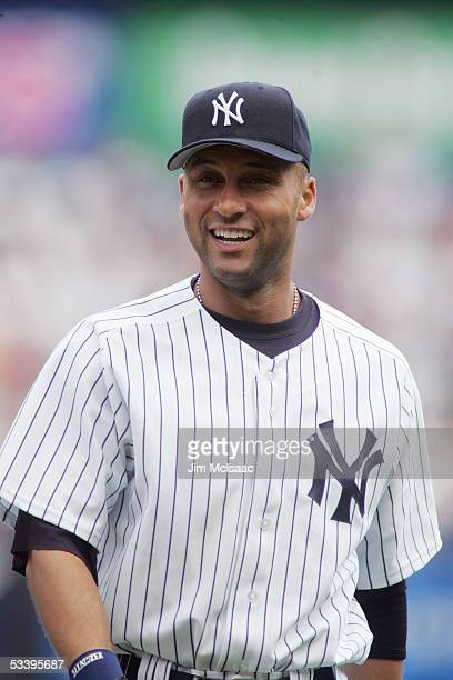 Infielder Derek Jeter of the New York Yankees looks on against the Los Angeles Angels of Anaheim on July 31 2005 at Yankee Stadium in the Bronx...