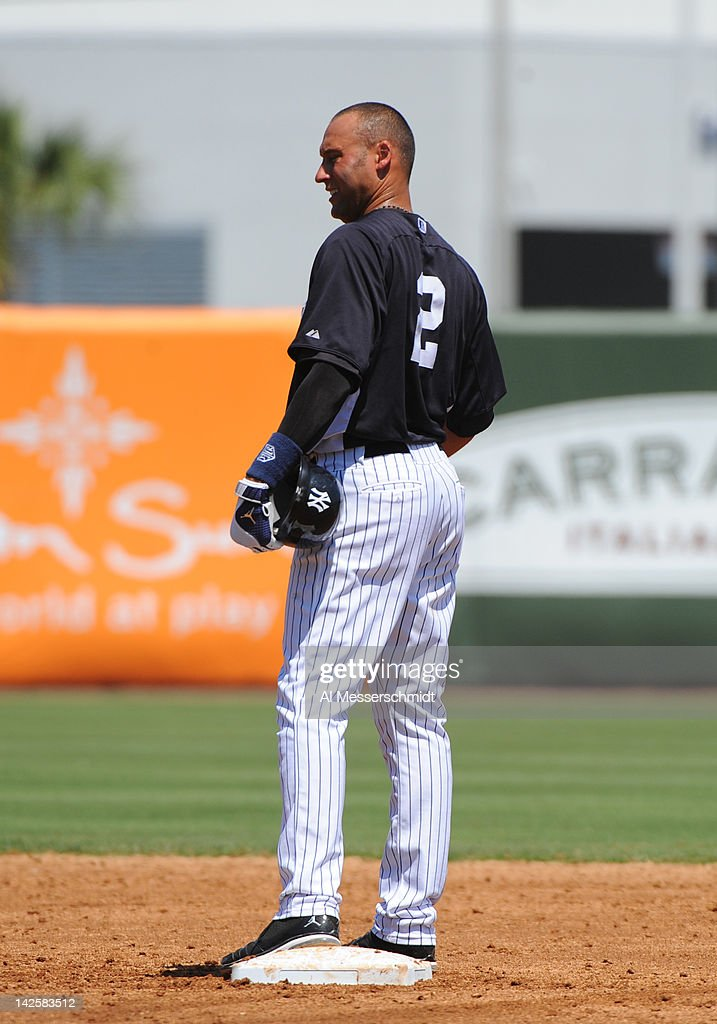 Infielder Derek Jeter #2 of the New York Yankees stands at second base after a hit against the New York Mets in a spring training game April 4, 2012 at George M. Steinbrenner Field in Tampa, Florida.