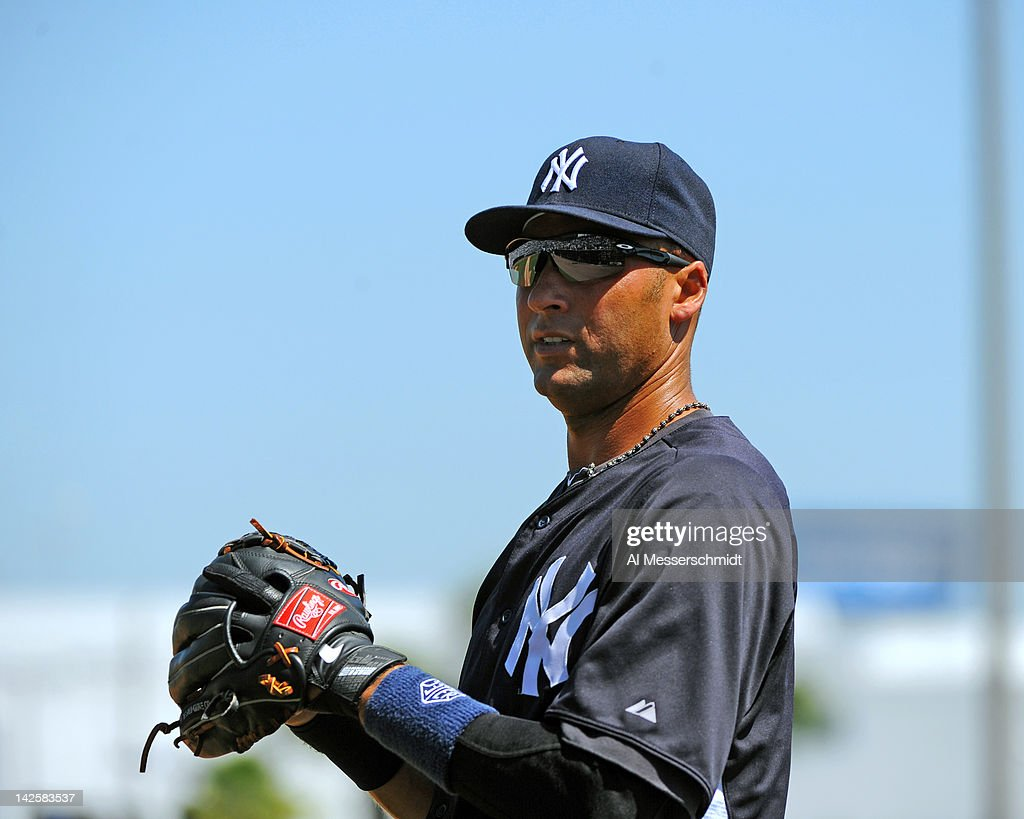 Infielder Derek Jeter #2 of the New York Yankees wams up for play against the New York Mets in a spring training game April 4, 2012 at George M. Steinbrenner Field in Tampa, Florida.