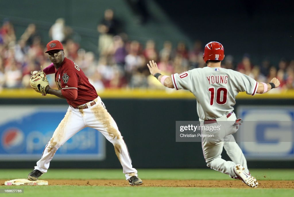 Infielder Didi Gregorius #1 of the Arizona Diamondbacks throws over the sliding <a gi-track='captionPersonalityLinkClicked' href=/galleries/search?phrase=Michael+Young+-+Baseball+Player&family=editorial&specificpeople=203149 ng-click='$event.stopPropagation()'>Michael Young</a> #10 of the Philadelphia Phillies to complete a double play during the eighth inning of the MLB game at Chase Field on May 12, 2013 in Phoenix, Arizona.