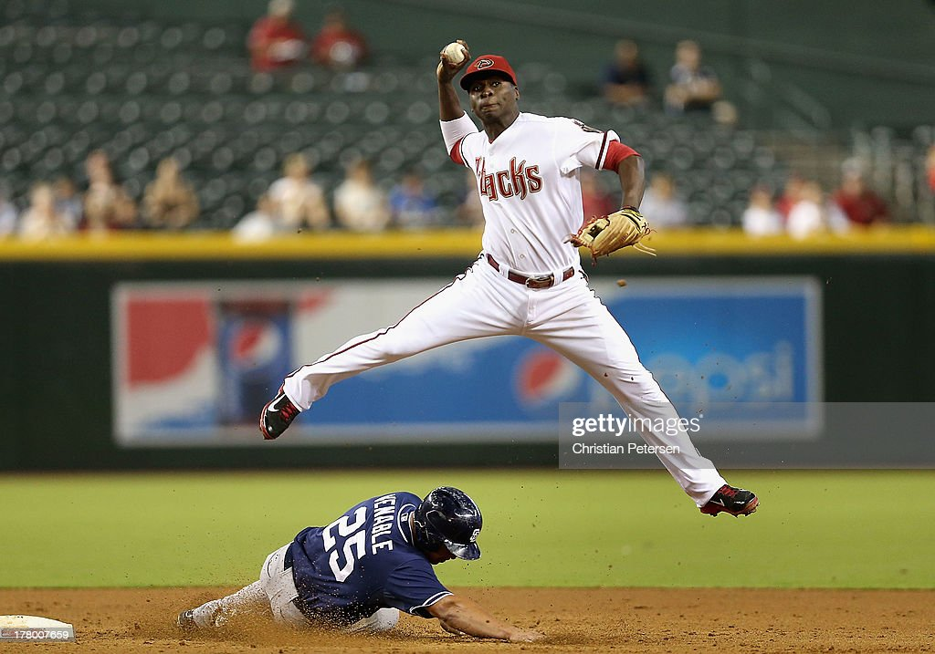 Infielder Didi Gregorius of the Arizona Diamondbacks throws over the sliding Will Venable of the San Diego Padres to complete a double during the...