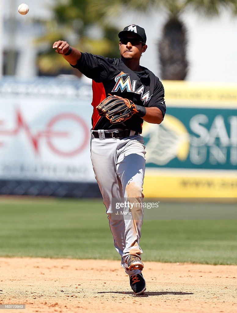 Infielder Donovan Solano #17 of the Miami Marlins throws over to first for an out against the New York Yankees during a Grapefruit League Spring Training Game at George M. Steinbrenner Field on March 15, 2013 in Tampa, Florida.