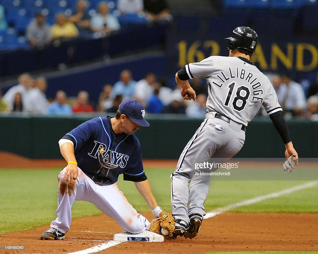 Infielder <a gi-track='captionPersonalityLinkClicked' href=/galleries/search?phrase=Drew+Sutton&family=editorial&specificpeople=4755095 ng-click='$event.stopPropagation()'>Drew Sutton</a> #44 of the Tampa Bay Rays tags out pinch runner <a gi-track='captionPersonalityLinkClicked' href=/galleries/search?phrase=Brent+Lillibridge&family=editorial&specificpeople=4164757 ng-click='$event.stopPropagation()'>Brent Lillibridge</a> #18 of the Chicago White Sox at third base May 30, 2012 at Tropicana Field in St. Petersburg, Florida.
