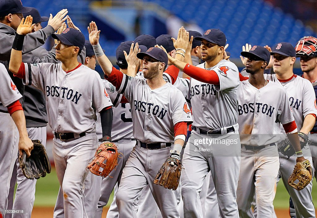 Infielder <a gi-track='captionPersonalityLinkClicked' href=/galleries/search?phrase=Dustin+Pedroia&family=editorial&specificpeople=836339 ng-click='$event.stopPropagation()'>Dustin Pedroia</a> #15 of the Boston Red Sox celebrates victory over the Tampa Bay Rays at Tropicana Field on September 18, 2012 in St. Petersburg, Florida.
