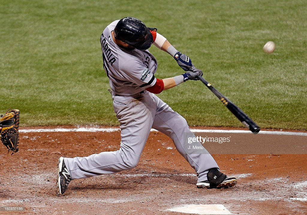 Infielder <a gi-track='captionPersonalityLinkClicked' href=/galleries/search?phrase=Dustin+Pedroia&family=editorial&specificpeople=836339 ng-click='$event.stopPropagation()'>Dustin Pedroia</a> #15 of the Boston Red Sox sacrifices in a run against the Tampa Bay Rays during the game at Tropicana Field on September 18, 2012 in St. Petersburg, Florida.