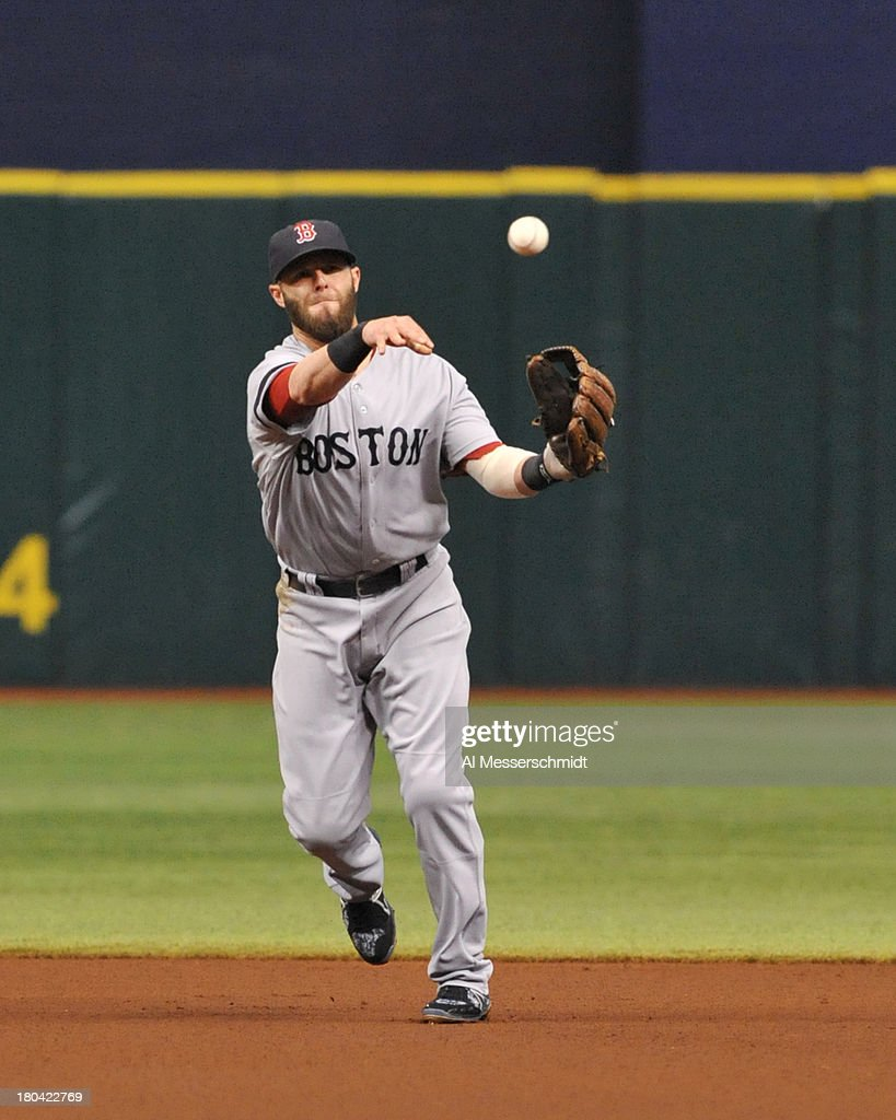 Infielder Dustin Pedroia #15 of the Boston Red Sox throws to 1st base against the Tampa Bay Rays September 12, 2013 at Tropicana Field in St. Petersburg, Florida.
