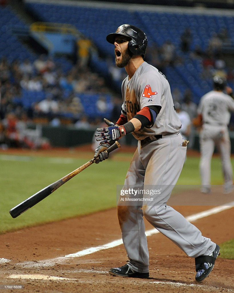 Infielder <a gi-track='captionPersonalityLinkClicked' href=/galleries/search?phrase=Dustin+Pedroia&family=editorial&specificpeople=836339 ng-click='$event.stopPropagation()'>Dustin Pedroia</a> #15 of the Boston Red Sox yells after a strikeout against the Tampa Bay Rays June 10, 2013 at Tropicana Field in St. Petersburg, Florida. Boston won 10 - 8 in 14 innings.
