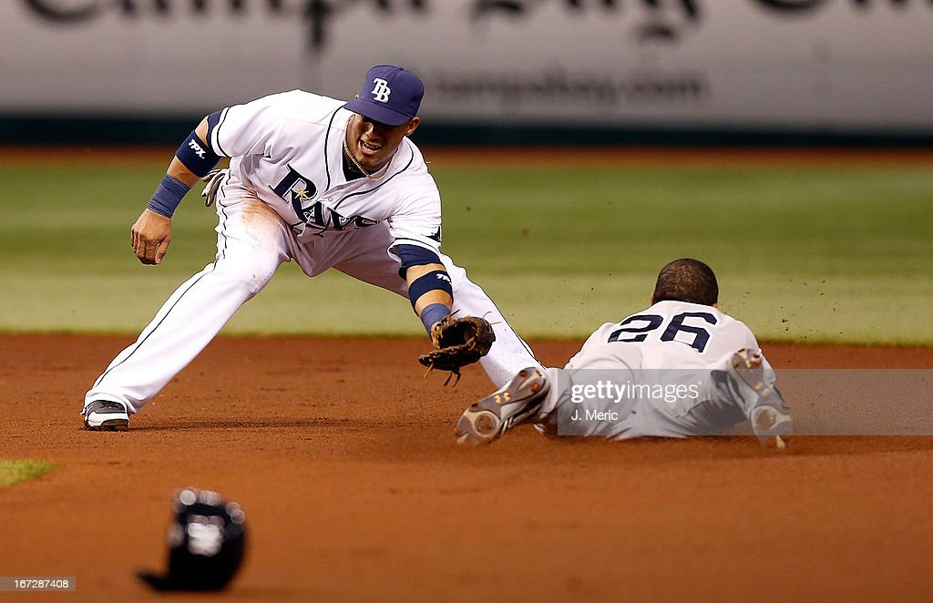 Infielder Eduardo Nunez #26 of the New York Yankees steals first base in the first inning as shortstop Yunel Escobar #11 of the Tampa Bay Rays is late with the tag during the game at Tropicana Field on April 23, 2013 in St. Petersburg, Florida.