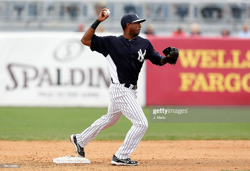 Infielder <a gi-track='captionPersonalityLinkClicked' href=/galleries/search?phrase=Eduardo+Nunez&family=editorial&specificpeople=4900197 ng-click='$event.stopPropagation()'>Eduardo Nunez</a> #26 of the New York Yankees throws over to first for an out against the Boston Red Sox during a Grapefruit League Spring Training Game at George M. Steinbrenner Field on March 20, 2013 in Tampa, Florida.